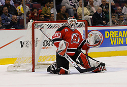 Mar 14, 2007; East Rutherford, NJ, USA;  New Jersey Devils goalie Martin Brodeur (30) readies for a save during the second period at Continental Airlines Arena in East Rutherford, NJ. Mandatory Credit: Ed Mulholland-US PRESSWIRE Copyright © 2007 Ed Mulholland