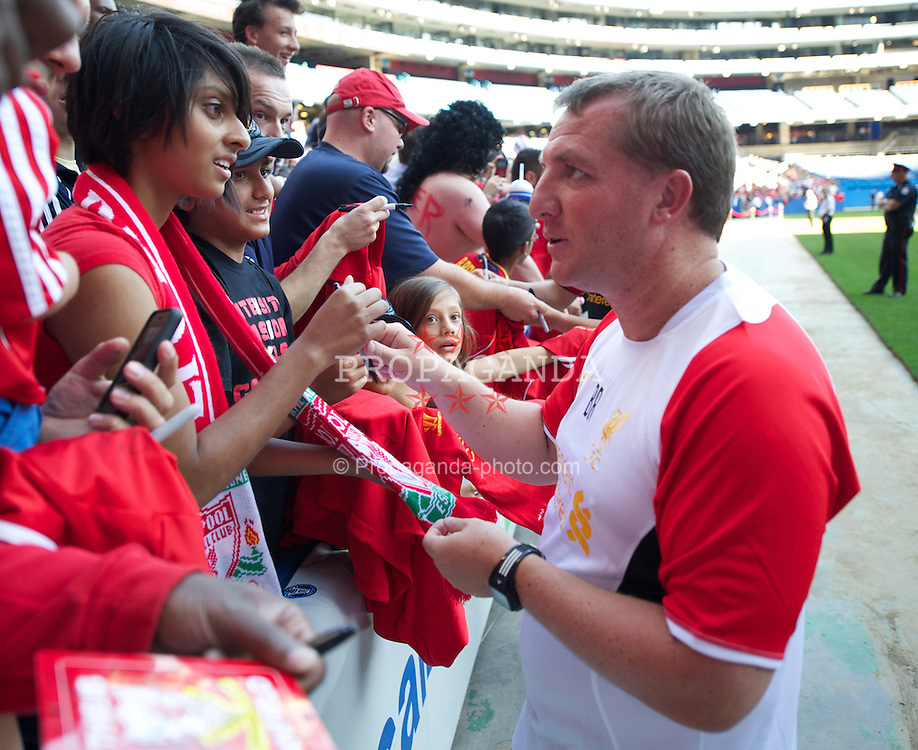 TORONTO, CANADA - Friday, July 20, 2012: Liverpool's manager Brendan Rodgers signs autographs for supporters after a training session ahead of the side's first match of their North American pre-season tour against Toronto FC at the Rogers Centre. (Pic by David Rawcliffe/Propaganda)