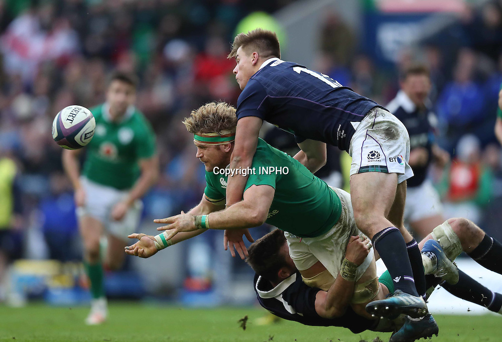 RBS 6 Nations Championship Round 1, BT Murrayfield, Scotland 4/2/2017<br /> Scotland vs Ireland<br /> Ireland&rsquo;s Jamie Heaslip is tackled by Scotland&rsquo;s Huw Jones<br /> Mandatory Credit &copy;INPHO/Billy Stickland