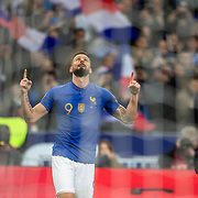 PARIS, FRANCE - March 25:  Olivier Giroud #9 of France celebrates after scoring a goal watched by team mate Raphael Varane #4 of France during the France V Iceland, 2020 European Championship Qualifying, Group Stage at  Stade de France on March 25th 2019 in Paris, France (Photo by Tim Clayton/Corbis via Getty Images)
