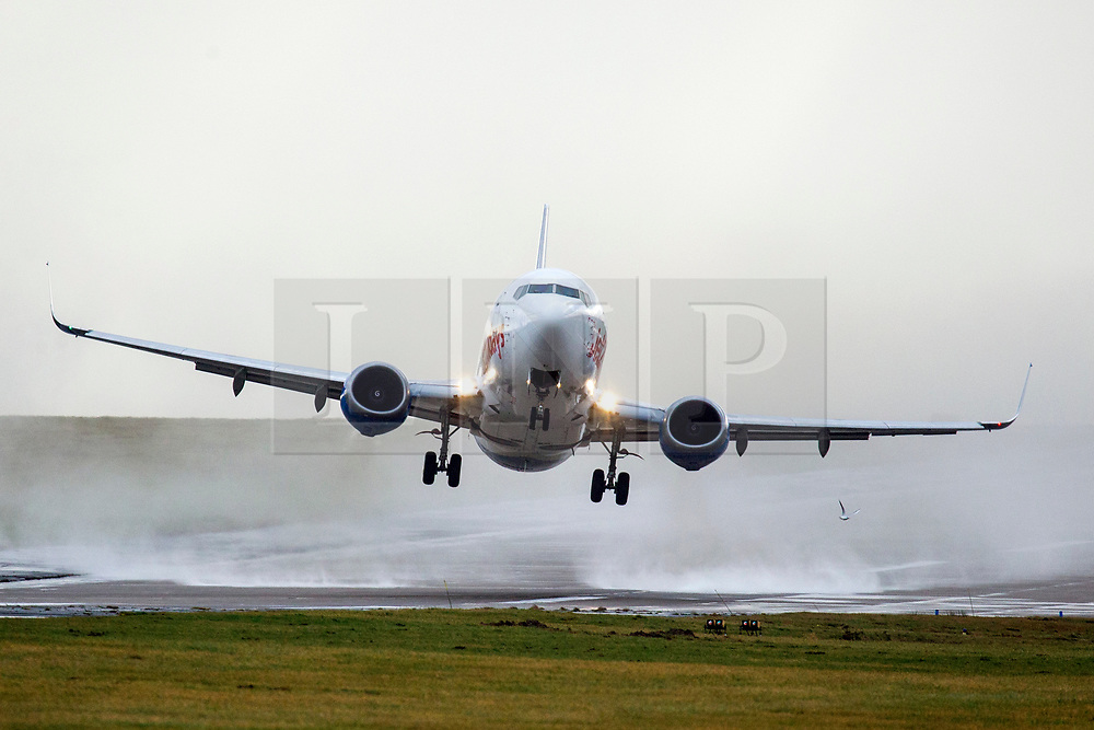 © Licensed to London News Pictures. 09/02/2019. Leeds UK. A Jet2 aircraft taking off at Leeds Bradford airport this morning as strong winds from Storm Erik continue to batter the UK. Photo credit: Andrew McCaren/LNP
