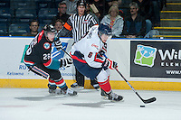 KELOWNA, CANADA - OCTOBER 16: Macoy Erkamps #6 of the Lethbridge Hurricanes handles the puck while being checked by Cole Linaker #26 of the Kelowna Rockets on October 16, 2013 at Prospera Place in Kelowna, British Columbia, Canada.   (Photo by Marissa Baecker/Shoot the Breeze)  ***  Local Caption  ***