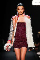 A model walks the runway wearing MONGOL Fall 2015 during Mercedes-Benz Fashion Week in New York on February 13, 2015