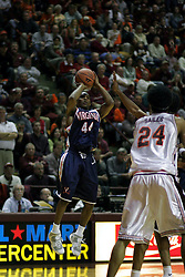 Sean Singletary (44) shoots one of his three 3-point shots against the Hokies.  Singletary's second-half run lead the Wahoos to a 54-49 victory over VT in Blacksburg.
