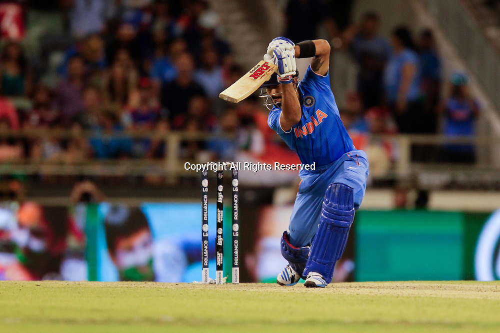 06.03.2015. Perth, Australia. ICC Cricket World Cup. India versus West Indies. Virat Kholi plays a cover drive during his innings.