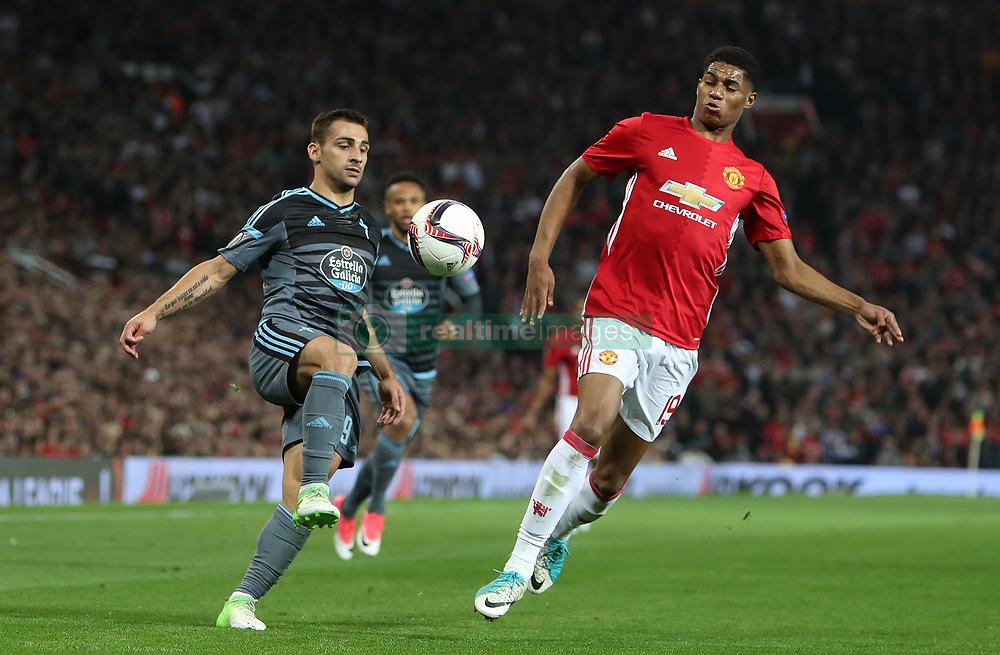 Celta Vigo's Jonny Castro (left) and Manchester United's Marcus Rashford in action