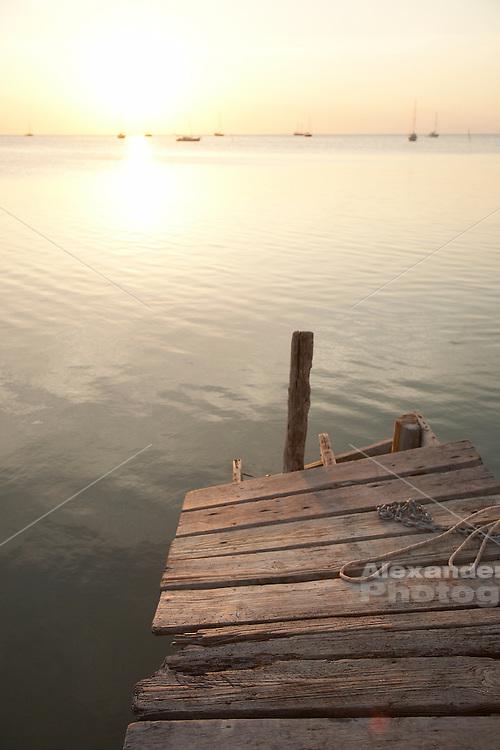Belize, Central America - Old wooden pier on Caye Caulker waterfront.