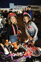 Bella Rocha, left, and Savanna Radowicz, prepare to ride their Xmas bikes in the parade on Sunday evening. Thousands of Salinas residents turned out to experience the magic of the 14th annual Holiday Parade of Lights in Oldtown Salinas.
