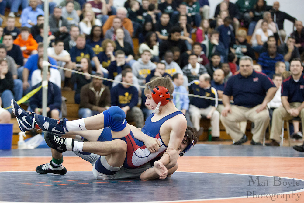 John Amato of Timber Creek High School defeats Mike Van Horn of Washington Township High School, by major decision 14-2, in the District 30 Wrestling 106lb weight class final at Overbrook High School on February 18, 2012. (photo / Mat Boyle)