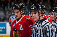 KELOWNA, CANADA - JANUARY 21: Colton Veloso #39 of the Portland Winterhawks stands on the ice with linesman Kevin Crowell against the Kelowna Rockets on January 21, 2017 at Prospera Place in Kelowna, British Columbia, Canada.  (Photo by Marissa Baecker/Shoot the Breeze)  *** Local Caption ***