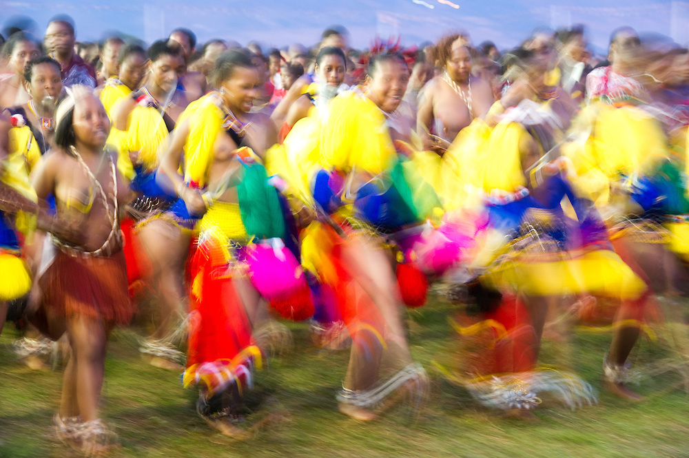 Ludzidzini, Swaziland, Africa - Annual Umhlanga, or reed dance ceremony, in which up to 100,000 young Swazi women gather to celebrate their virginity and honor the queen mother during the 8 day long event.<br /> Maidens dancing at the royal dancing grounds