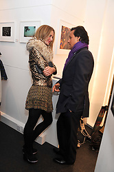 TRINNY WOODALL and ARUN NAYER at a private view of photographs by Anthony Souza held at The Little Black Gallery, 13A Park Walk, London SW10 on 13th December 2011.