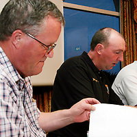 Treasurer Michael McInerney, fixtures secretary Michael Leydon and vice chairman Paul Touhy take a look through the agenda at the Clare Soccer League AGM in the Clare Inn on Thursday evening,.<br /><br /><br /><br />Photograph by Yvonne Vaughan.