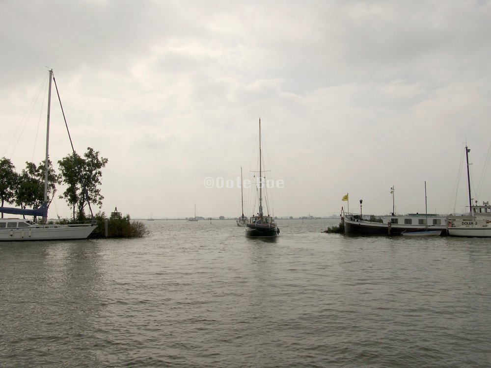 recreational sailing boat leaving the harbor Holland