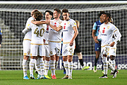 The Milton Keynes Dons players  celebrate Milton Keynes Dons midfielder Brennan Dickenson (11) goal 1-0 during the EFL Trophy match between Milton Keynes Dons and Wycombe Wanderers at stadium:mk, Milton Keynes, England on 12 November 2019.