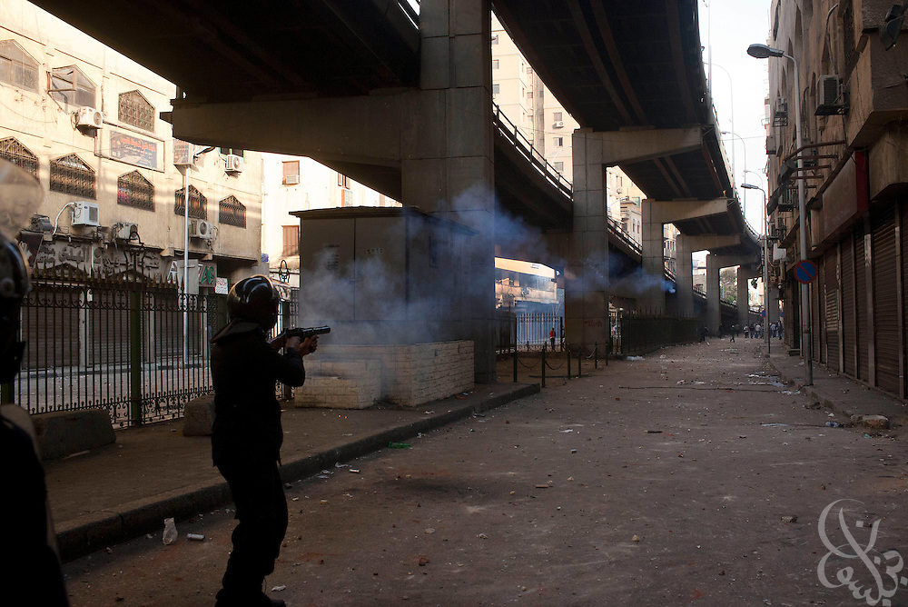 Egyptian riot police fire tear gas at protestors on Al-Azhar street during massive and unprecedented demonstrations January 28, 2011 across Cairo, Egypt . The protests, inspired by the recent revolution in Tunisia, have struck a chord with Egypt's population, tired of inflation, high unemployment and alleged corruption within the Mubarak government..Slug: Egypt.Credit: Scott Nelson for the New York Times