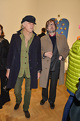 Left to right, SIR BOB GELDOF and JARVIS COCKER at the opening private view of 'A Strong Sweet Smell of Incense - A portrait of Robert Fraser, held at the Pace Gallery, Burlington Gardens, London on 5th February 2015.
