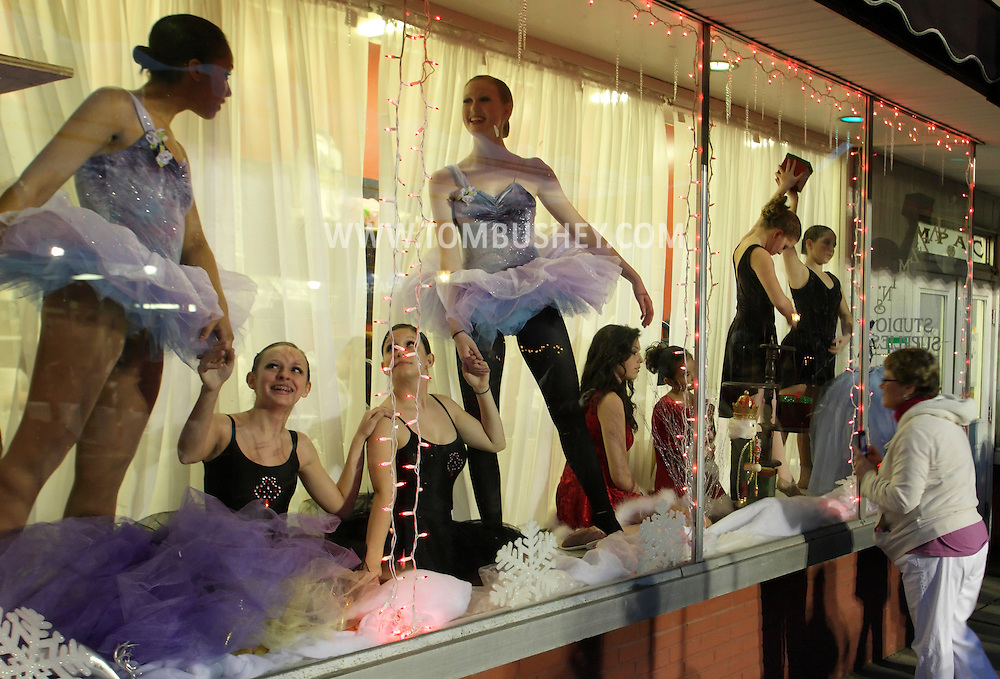 Pine Bush, New York  - Dancers from the Mitchell Performing Arts Center pose in the center's window during A Community Country Christmas 2011 on  Dec. 3, 2011.