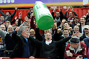 Northampton Town fans throwing a giant inflatable Champaigne bottle around the away end in celebration before the Sky Bet League 2 match between Exeter City and Northampton Town at St James' Park, Exeter, England on 16 April 2016. Photo by Graham Hunt.