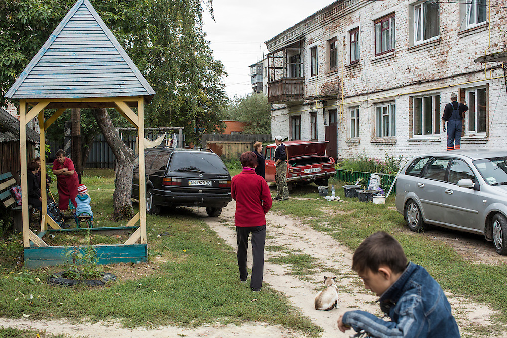 SEMYONOVKA, UKRAINE - SEPTEMBER 13, 2015: Local residents outside the building that houses the office of the local Communist party in Semyonovka, Ukraine. A statue of Vladimir I. Lenin, which was taken down from the town square in the immediate aftermath of the collapse of the government of President Viktor Yanukovych in February 2014, was erected again in a new, more discreet, location two months later based in part by a petition to the city council submitted by the local Communist party. A new decommunization law has stirred criticism as being a diversion from more pressing issues of war and the economy. CREDIT: Brendan Hoffman for The New York Times