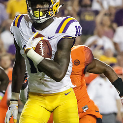 Sep 23, 2017; Baton Rouge, LA, USA; LSU Tigers wide receiver Stephen Sullivan (10) runs after a catch for a touchdown against the Syracuse Orange during the second quarter of a game at Tiger Stadium. Mandatory Credit: Derick E. Hingle-USA TODAY Sports