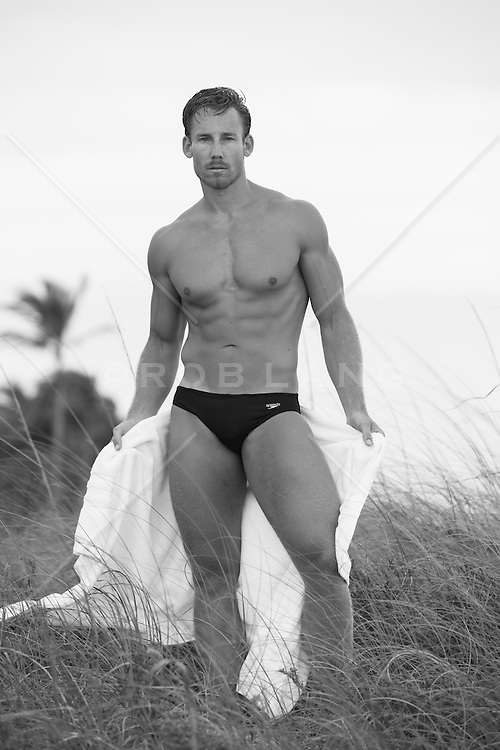 sexy man in a speedo on the beach