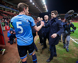 STOKE-ON-TRENT, ENGLAND - Monday, April 18, 2016: Tottenham Hotspur's manager Mauricio Pochettino celebrates with captain Jan Vertonghen after the 4-0 victory over Stoke City during the FA Premier League match at the Britannia Stadium. (Pic by David Rawcliffe/Propaganda)
