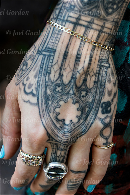 Storm Ritter's Tattoos on her hands and fingers.<br /> <br /> Tattoos are no longer just a male thing, young women are just as likely to get a tattoo as males. <br /> <br /> Body art or tattoos has entered the mainstream it is no longer considered a weird kind of subculture.<br /> <br /> &quot;According to a 2006 Pew survey, 40% of Americans between the ages of 26 and 40 have been tattooed&quot;.