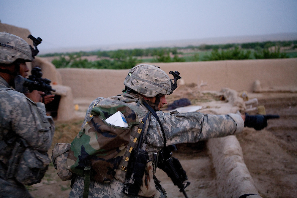 Sargeant Lawrence Buckius, right, of the 82nd Airborne's 1/508 Parachute Infantry Regiment, Alpha Company, Third Platoon directs his squad during an air assault into Sangin, Helmand province, the largest air assault in Afghanistan since the beginning of the war, on Thursday, April 5, 2007.