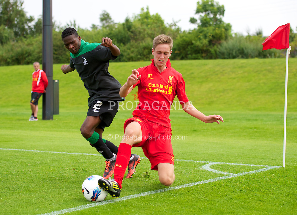KIRKBY, ENGLAND - Saturday, August 11, 2012: Liverpool's Jordan Sinclair in action against Nottingham Forest's Eurico Sebastiao during a friendly match at the Kirkby Academy. (Pic by David Rawcliffe/Propaganda)