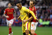 Nottingham Forest midfielder David Vaughan holds on to MK Dons forward Rob Hall during the Sky Bet Championship match between Nottingham Forest and Milton Keynes Dons at the City Ground, Nottingham, England on 19 December 2015. Photo by Aaron Lupton.
