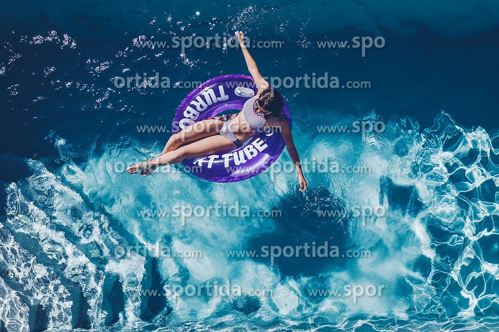 THEMENBILD - eine jugendliche auf einem Schwimmreifen im Swimmingpool an einem heissen Sommertag, aufgenommen am 25. Juni 2019 in Kaprun, Österreich // a teenager on a swimming tire in the swimming pool on a hot summer day, Kaprun, Austria on 2019/06/25. EXPA Pictures © 2019, PhotoCredit: EXPA/ JFK