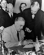 President Franklin Roosevelt signing the United states declaration of war against Germany, Dec. 11, 1941