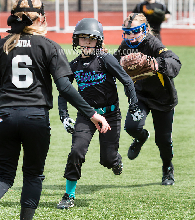 Chester, New York - Players compete in the It's Show Time girls' softball tournament at the Rock Sports Complex  on April 11, 2015.