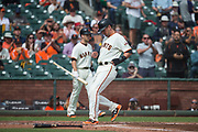 San Francisco Giants second baseman Joe Panik (12) scores a run against the Colorado Rockies at AT&T Park in San Francisco, California, on September 20, 2017. (Stan Olszewski/Special to S.F. Examiner)