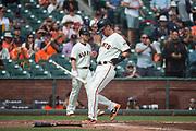 San Francisco Giants second baseman Joe Panik (12) scores a run against the Colorado Rockies at AT&T Park in San Francisco, California, on September 20, 2017. (Stan Olszewski/Special to S.F. Examiner)