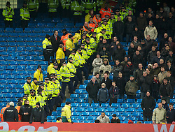 MANCHESTER, ENGLAND - Sunday, February 13, 2010: Police watch over the Stoke City supporters during the FA Cup 5th Round match at the City of Manchester Stadium. (Photo by David Rawcliffe/Propaganda)  MANCHESTER, ENGLAND - Sunday, February 13, 2010: Manchester City xxxx and Stoke City's xxxx during the FA Cup 5th Round match at the City of Manchester Stadium. (Photo by David Rawcliffe/Propaganda)