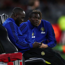 Romelu Lukaku of Manchester United on his phone as the team warms up