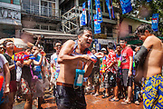 "13 APRIL 2013 - BANGKOK, THAILAND:  A Japanese tourist is deluged with water during a Songkran water fight on Khao San Road, which is Bangkok's ""backpacker"" district, during Songkran celebrations in the Thai capital. Songkran is celebrated in Thailand as the traditional New Year's Day from 13 to 16 April. The date of the festival was originally set by astrological calculation, but it is now fixed. If the days fall on a weekend, the missed days are taken on the weekdays immediately following. Songkran is in the hottest time of the year in Thailand, at the end of the dry season and provides an excuse for people to cool off in friendly water fights that take place throughout the country. Songkran has been a national holiday since 1940, when Thailand moved the first day of the year to January 1.   PHOTO BY JACK KURTZ"