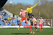 Oxford forward Jordan Bowery and Stevenage defender Luke Wilkinson challenge for a header during the Sky Bet League 2 match between Oxford United and Stevenage at the Kassam Stadium, Oxford, England on 25 March 2016. Photo by Alan Franklin.