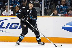February 17, 2011; San Jose, CA, USA;  San Jose Sharks defenseman Kent Huskins (40) skates with the puck against the Washington Capitals during the first period at HP Pavilion.  San Jose defeated Washington 3-2. Mandatory Credit: Jason O. Watson / US PRESSWIRE