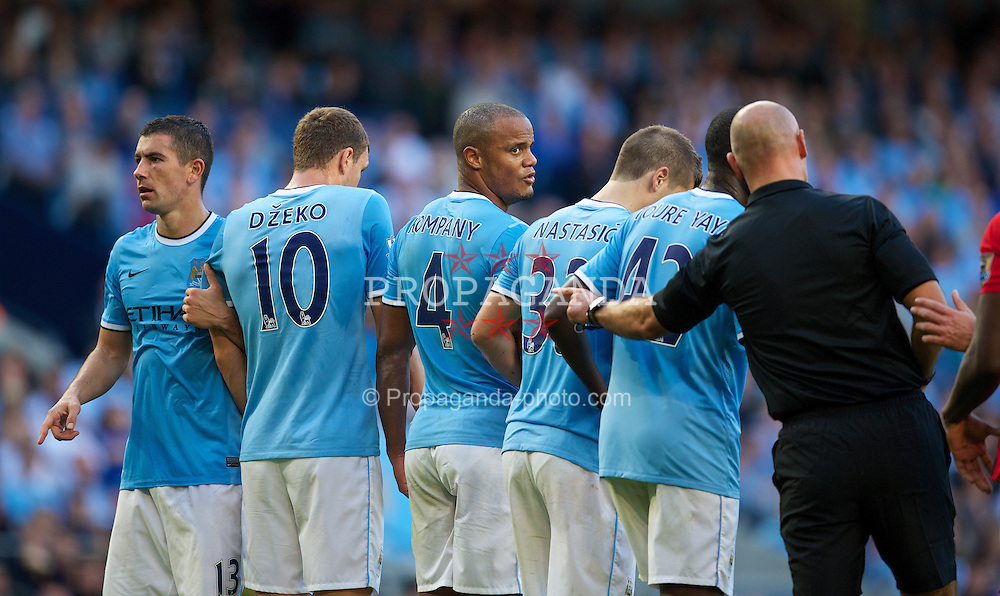 MANCHESTER, ENGLAND - Sunday, September 22, 2013: Manchester City's Vincent Kompany forms a defensive wall against Manchester United during the Premiership match at the City of Manchester Stadium. (Pic by David Rawcliffe/Propaganda)