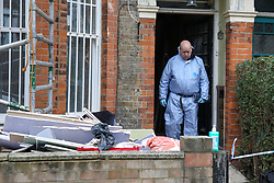 © Licensed to London News Pictures. 25/01/2020. London, UK. A forensic officer at a property on Mount Pleasant Road in Clapton, East London. Police launch a murder investigation at a residential property following fatal stabbing after 11pm on Friday 24 January following reports of a disturbance. A man was found with stab injuries inside the property and died later. A 27 year old man was arrested at the scene on suspicion of murder. Photo credit: Dinendra Haria/LNP