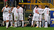 Midfielder David Beckham of AC Milan celebrates with his new team mates and Ronaldinho during the Serie A match between AS Roma v AC Milan held at Stadio Olimpico on January 11, 2009 in Rome, Italy.