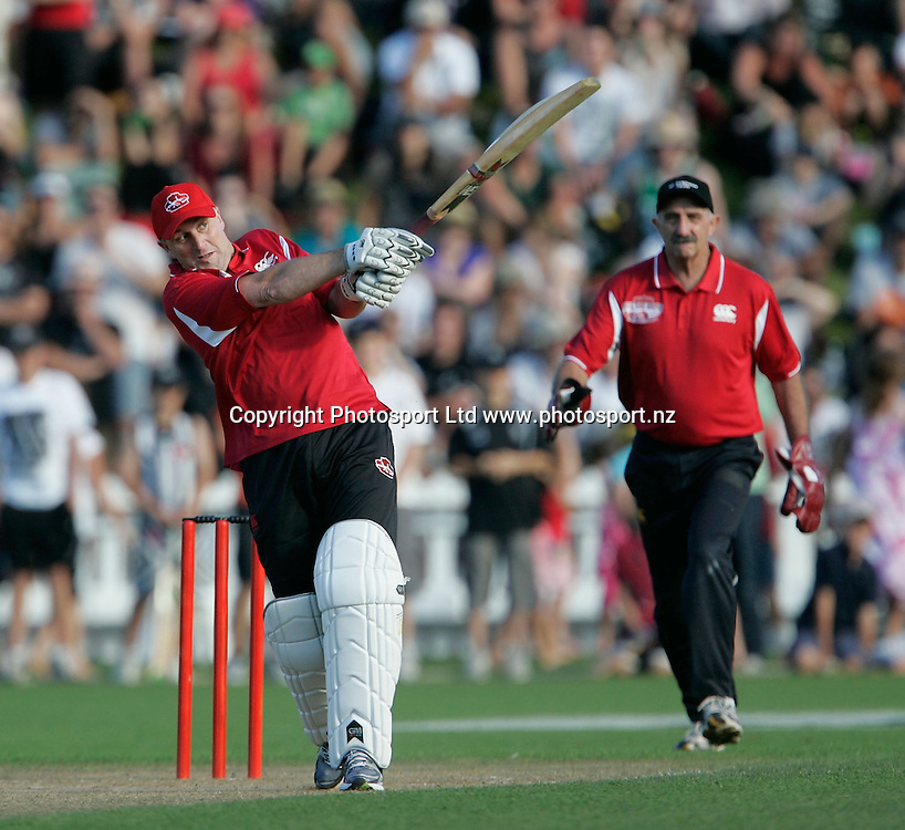 Cricket Quake Relief Game Basin Reserve. 13.3.2011 PM John Key lifts Shane Warne for 4  John Carter MP standing in as keeper..Bush pic  2