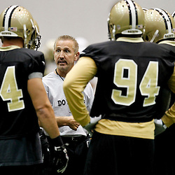 July 26, 2012; Metairie, LA, USA; New Orleans Saints defensive coordinator Steve Spagnuolo talks to players during the first day of of training camp at the team's indoor practice facility. Mandatory Credit: Derick E. Hingle-US PRESSWIRE