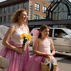 "The Strolling of the Heiffers Parade in Brattleboro, Vermont.  ""Dairy Godmother"" and her ""Dairy Princess"" spread good cheer."