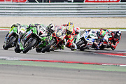 Leon Haslam (91) JG Speedfit Kawasaki leads the pack in race 1at the BSB Championship at the TT Circuit,  Assen, Netherlands on 2nd October 2016. Photo by Nigel Cole.