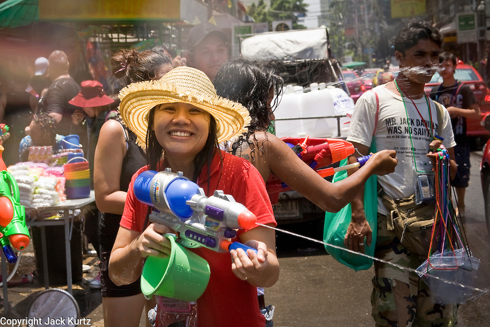 "Apr. 13, 2010 - Bangkok, Thailand: Thais and tourists get into water fights during Songkran festivities on a soi off of Sukhumvit Rd in Bangkok Tuesday. Songkran is the Thai New Year's holiday, celebrated from April 13 - 15. This year's official celebrations have been cancelled because of the Red Shirt protests but Thais are still marking the holiday. It's one of the most popular holidays in Thailand. Songkran originally was celebrated only in the north of Thailand, and was adapted from the Indian Holi festival. Except the Thais throw water instead of colored powder. The throwing of water originated as a way to pay respect to people, by capturing the water after it had been poured over the Buddhas for cleansing and then using this ""blessed"" water to give good fortune to elders and family by gently pouring it on the shoulder. Among young people the holiday evolved to include dousing strangers with water to relieve the heat, since April is the hottest month in Thailand (temperatures can rise to over 100°F or 40°C on some days). This has further evolved into water fights and splashing water over people riding in vehicles. The water is meant as a symbol of washing all of the bad away and is sometimes filled with fragrant herbs when celebrated in the traditional manner. Photo by Jack Kurtz"