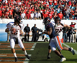Virginia linebacker Clint Sintim (51) sacks Texas Tech quarterback Graham Harrell (6) in the end zone for a safety.  The Texas Tech Red Raiders defeated the Virginia Cavaliers 31-28 in the 2008 Konica Menolta Gator Bowl held at the Jacksonville Municipal Stadium in Jacksonville, FL on January 1, 2008.